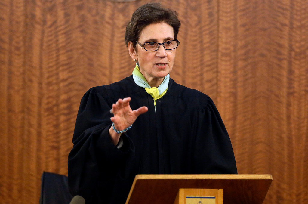 . Superior Court Judge E. Susan Garsh instructs the jury during the murder trial for former New England Patriots football player Aaron Hernandez, Thursday, Jan. 29, 2015, in Fall River, Mass. Hernandez is charged with killing semiprofessional football player Odin Lloyd, 27, in June 2013.  (AP Photo/Steven Senne, Pool)