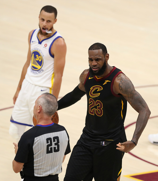 . Cleveland Cavaliers\' LeBron James argues a call with referee Jason Phillips (23) in the first half of Game 4 of basketball\'s NBA Finals against the Golden State Warriors, Friday, June 8, 2018, in Cleveland. (AP Photo/Carlos Osorio)