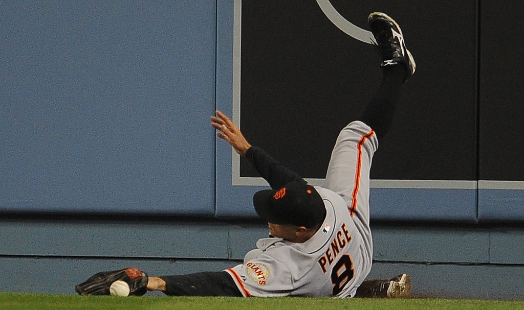 . San Francisco Giants right fielder Hunter Pence falls down chasing a single by Los Angeles Dodgers\' A.J. Ellis (not pictured) in the second inning of their baseball game on Wednesday, April 3, 2013 in Los Angeles. 