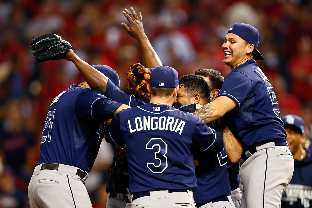 . CLEVELAND, OH - OCTOBER 02:  Evan Longoria #3 of the Tampa Bay Rays celebrates with his teammates after defeating the Cleveland Indians in the American League Wild Card game at Progressive Field on October 2, 2013 in Cleveland, Ohio.  (Photo by Jared Wickerham/Getty Images)