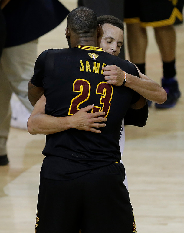 . Cleveland Cavaliers forward LeBron James (23) hugs Golden State Warriors guard Stephen Curry after Game 5 of basketball\'s NBA Finals in Oakland, Calif., Monday, June 12, 2017. The Warriors won 129-120 to win the NBA championship. (AP Photo/Ben Margot)