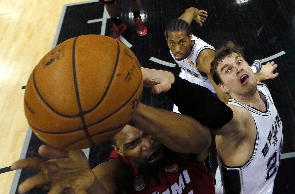 . Chris Bosh #1 of the Miami Heat goes up for a shot against Tiago Splitter #22 of the San Antonio Spurs in the first quarter during Game Three of the 2013 NBA Finals at the AT&T Center on June 11, 2013 in San Antonio, Texas.   (Photo by Mike Ehrmann/Getty Images)