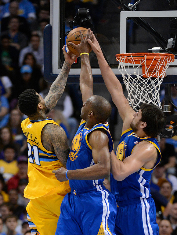 . DENVER, CO. - APRIL 20: Denver Nuggets shooting guard Wilson Chandler (21) has his shot blocked by Golden State Warriors power forward Carl Landry (7) and Golden State Warriors center Andrew Bogut (12) in the fourth quarter. The Denver Nuggets took on the Golden State Warriors in Game 1 of the Western Conference First Round Series at the Pepsi Center in Denver, Colo. on April 20, 2013. (Photo by John Leyba/The Denver Post)