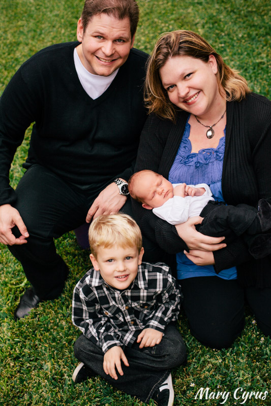 A family poses with their newborn son at home | Family Portraits in Dallas, Texas & Beyond by Mary Cyrus Photography