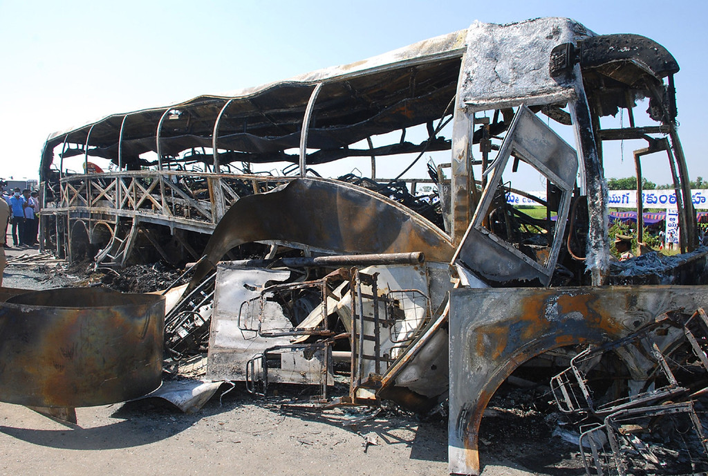 . The skeletal remains of a burnt-out bus which was traveling from Bangalore to Hyderabad, are seen on the highway in Mahbubnagar district of the southern Andhra Pradesh state, about 140 kms from Hyderabad on October 30, 2013.    AFP PHOTOSTR/AFP/Getty Images