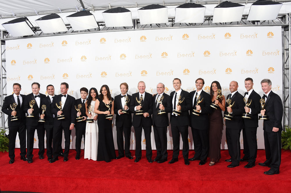 . Host Phil Keoghan, Executive Producers Elise Doganieri, Jerry Bruckheimer, Bertram van Munster, Jonathan Littman and other production member, winners of the Outstanding Reality - Competition Program Award for The Amazing Race pose in the press room during the 66th Annual Primetime Emmy Awards held at Nokia Theatre L.A. Live on August 25, 2014 in Los Angeles, California.  (Photo by Jason Merritt/Getty Images)