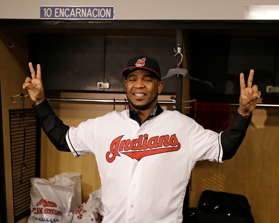. Cleveland Indians\' Edwin Encarnacion smiles wearing a Cleveland Indians baseball jersey, Thursday, Jan. 5, 2017, in Cleveland. One win from a World Series title last season, the Indians finalized a $65 million, three-year contract with free agent slugger Encarnacion. (AP Photo/Tony Dejak)