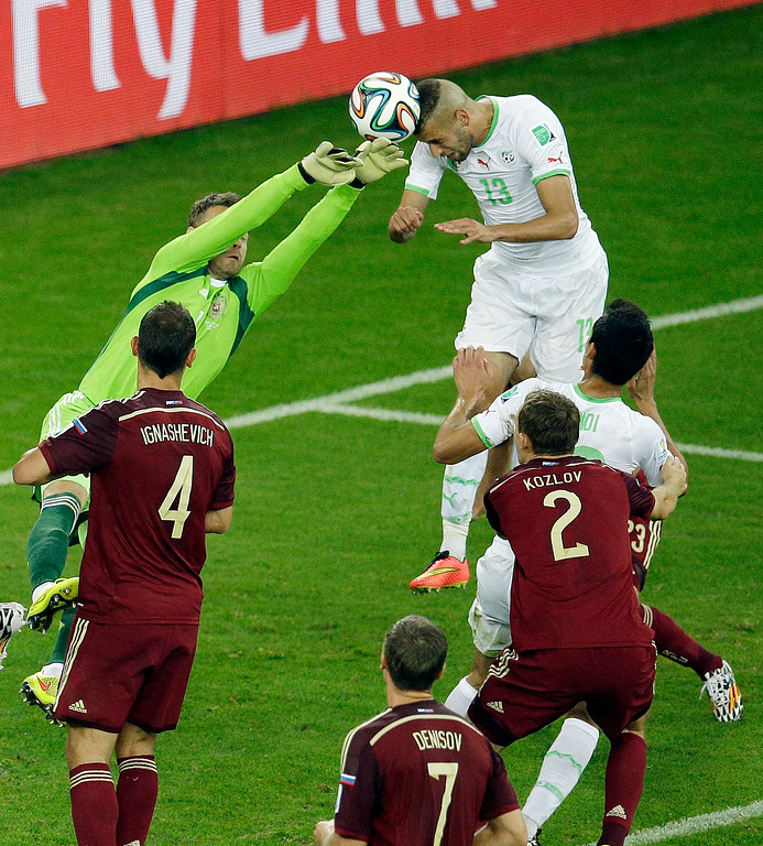 . Algeria\'s Islam Slimani scores his side\'s first goal during the group H World Cup soccer match between Algeria and Russia at the Arena da Baixada in Curitiba, Brazil, Thursday, June 26, 2014. (AP Photo/Michael Sohn)