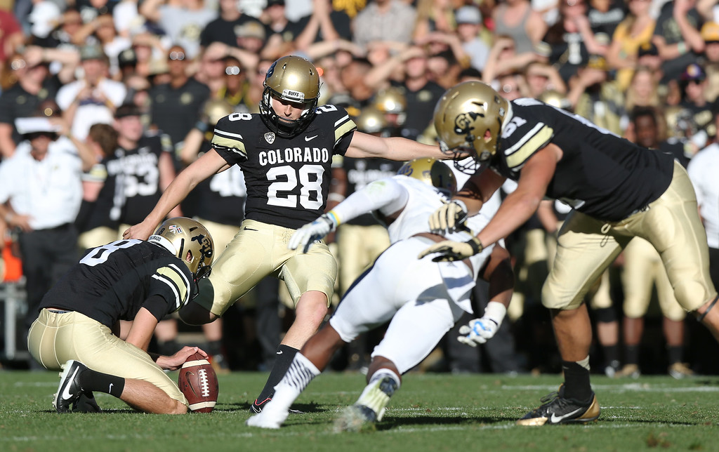 . Colorado place kicker Will Oliver, second from left, kicks a field goal from the hold of Darragh O\'Neill against UCLA in the second overtime of UCLA\' 40-37 victory in double overtime in an NCAA football game in Boulder, Colo., on Saturday, Oct. 25, 2014. (AP Photo/David Zalubowski)