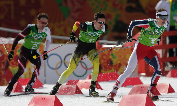 . Austria\'s Christoph Bieler, Germany\'s Bjoern Kircheisen and Norway\'s Haavard Klemetsen, from left, compete during the cross-country portion of the Nordic combined Gundersen large hill team competition at the 2014 Winter Olympics, Thursday, Feb. 20, 2014, in Krasnaya Polyana, Russia. (AP Photo/Matthias Schrader)
