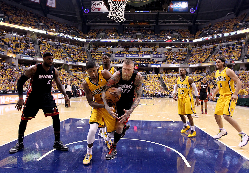 . Paul George #24 of the Indiana Pacers and Chris Andersen #11 of the Miami Heat battle for a loose ball during Game Two of the Eastern Conference Finals of the 2014 NBA Playoffs at at Bankers Life Fieldhouse on May 20, 2014 in Indianapolis, Indiana.   (Photo by Andy Lyons/Getty Images)