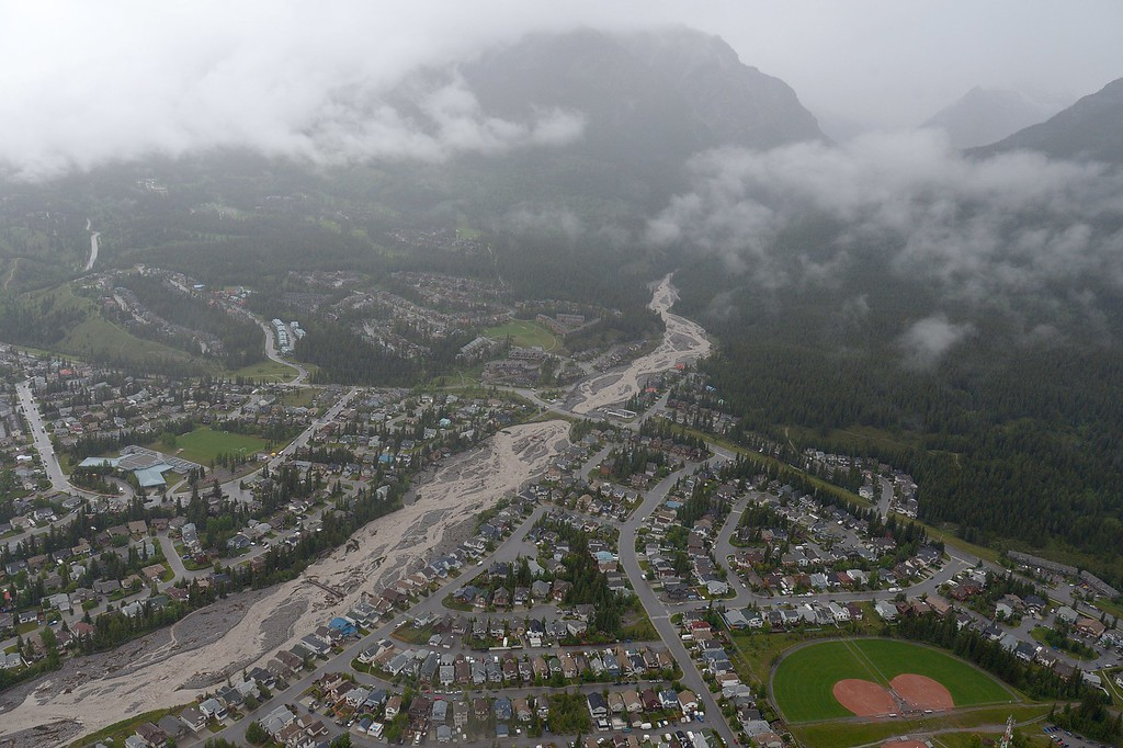 . This aerial photo shows Cougar Creek running through Canmore, Alberta, Canada, on Friday June 21, 2013.   (AP Photo/The Canadian Press, Jonathan Hayward)