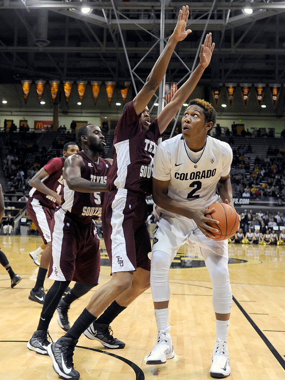 . University of Colorado\'s Xavier Johnson drives to the hoop past Lawrence Johnson-Danner during a game against Texas Southern on Tuesday, Nov. 27, at the Coors Event Center on the CU campus in Boulder.   Jeremy Papasso/ Camera