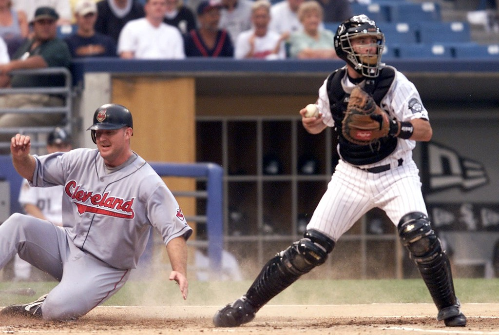 . Cleveland Indians\' Jim Thome, left, scores on a Marty Cordova double Thursday, July 19, 2001, as Chicago White Sox catcher Mark Johnson holds Cordova at second base in the first inning at Comiskey Park in Chicago. (AP Photo/Ted S. Warren)
