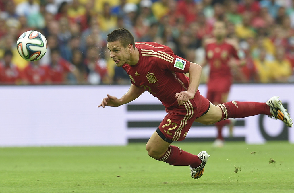 . Spain\'s midfielder Cesar Azpilicueta heads the ball during a Group B football match between Spain and Chile in the Maracana Stadium in Rio de Janeiro during the 2014 FIFA World Cup on June 18, 2014.   LLUIS GENE/AFP/Getty Images