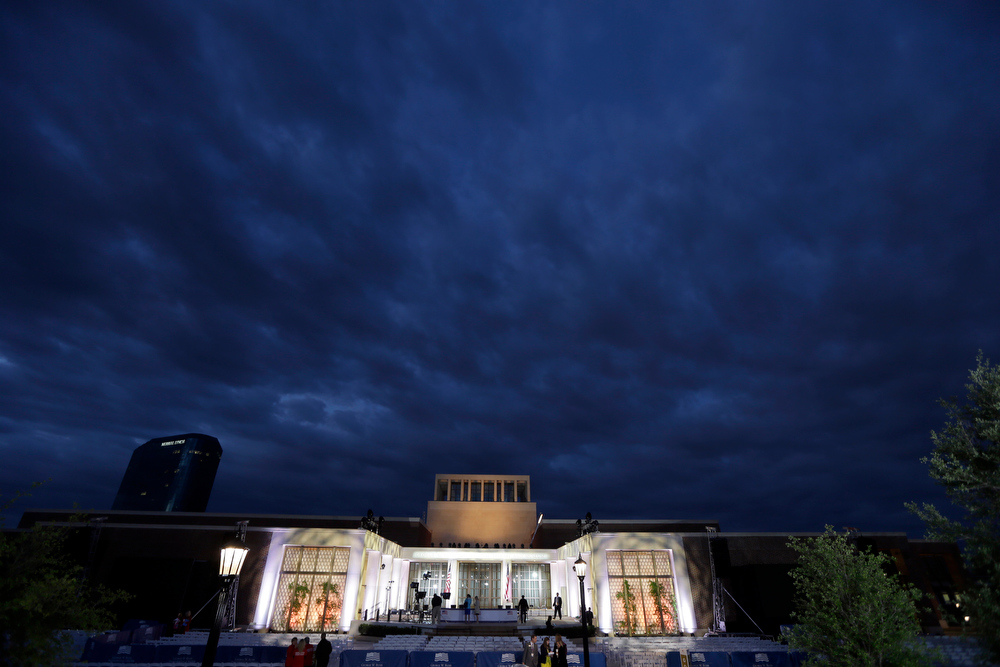 . Production crews put the finishing touches on the stage before the dedication ceremony of the George W. Bush Presidential Center, Thursday, April 25, 2013, in Dallas. (AP Photo/David J. Phillip)