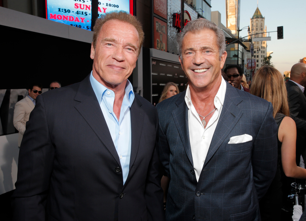 """. Arnold Schwarzenegger, left, and Mel Gibson arrive at the Los Angeles premiere of \""""The Expendables 3\"""" at the TCL Chinese Theatre on Monday, Aug. 11, 2014. (Photo by Todd Williamson/Invision/AP)"""