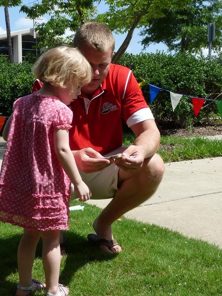 Samford football player & little girl.jpg