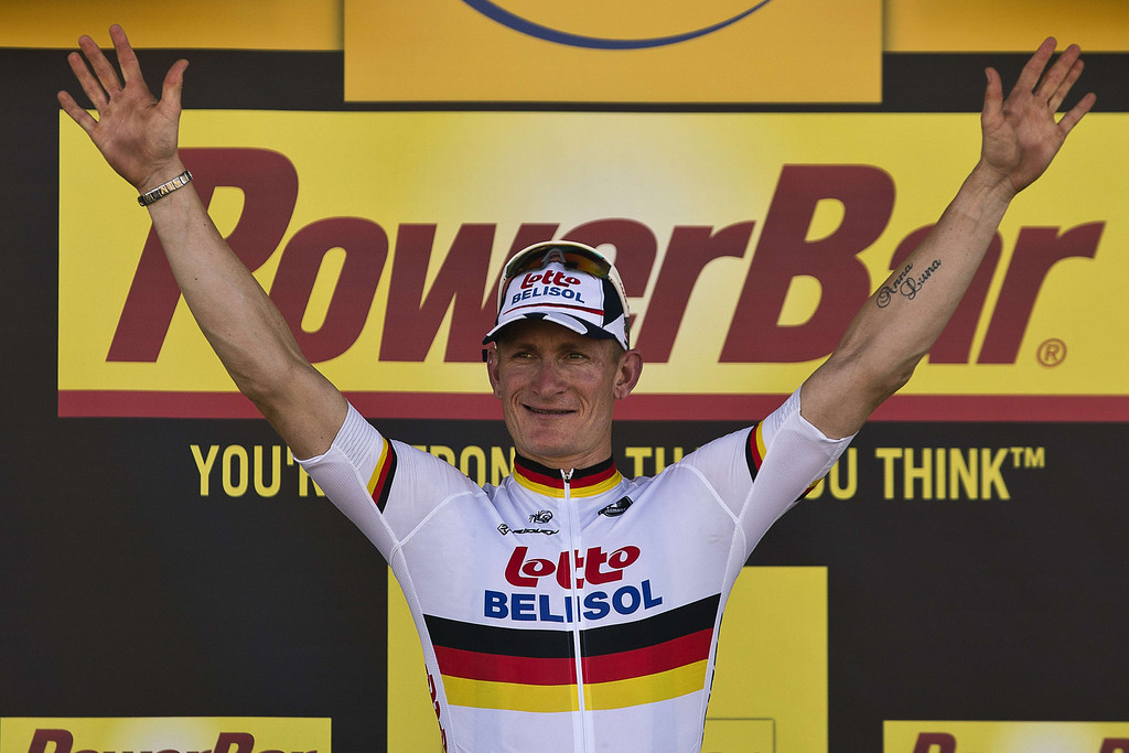 . Stage winner Germany\'s Andre Greipel celebrates on the podium after winning the 176.5 km sixth stage of the 100th edition of the Tour de France cycling race on July 4, 2013 between Aix-en-Provence and Montpellier, southern France. JEFF PACHOUD/AFP/Getty Images