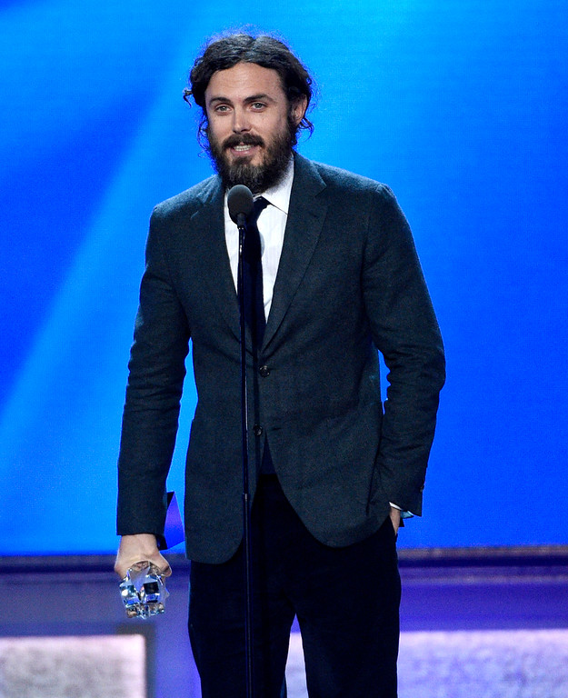 """. Casey Affleck accepts the award for best actor for \""""Manchester by the Sea\"""" at the 22nd annual Critics\' Choice Awards at the Barker Hangar on Sunday, Dec. 11, 2016, in Santa Monica, Calif. (Photo by Chris Pizzello/Invision/AP)"""