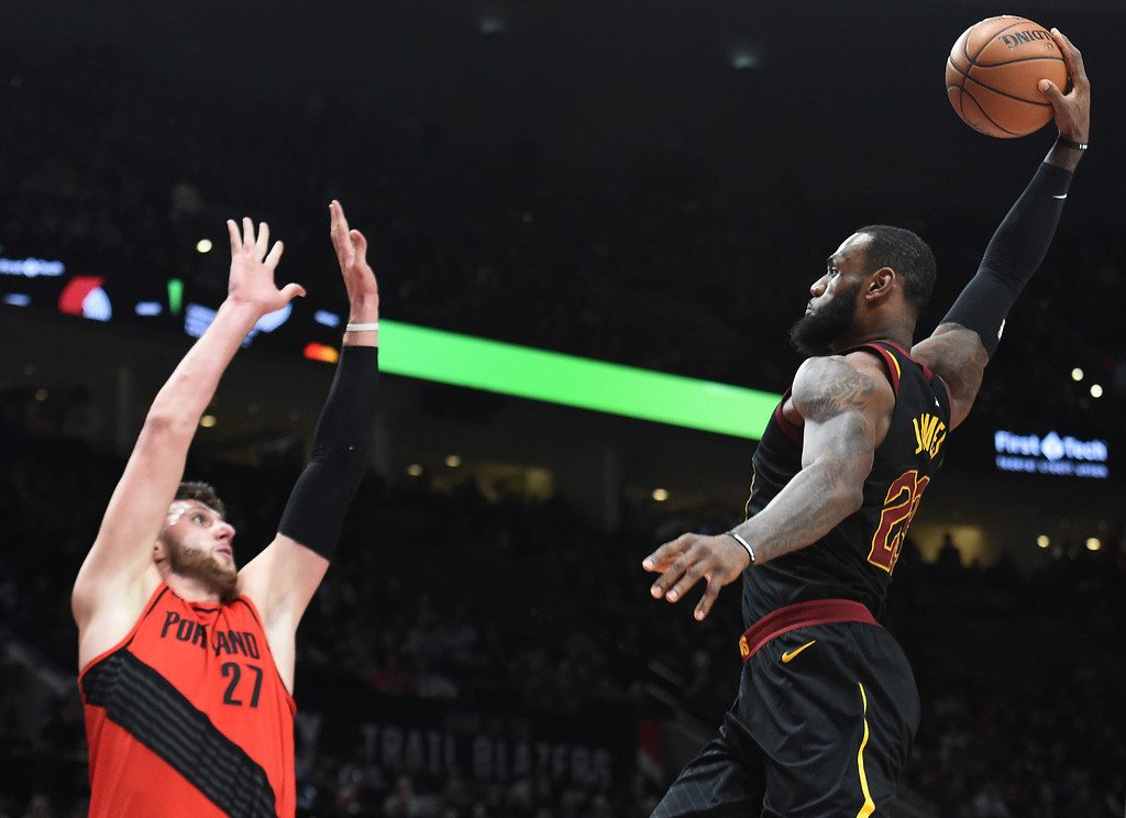 . Cleveland Cavaliers forward LeBron James, right, goes up for a dunk on Portland Trail Blazers center Jusuf Nurkic, left, during the first half of an NBA basketball game in Portland, Ore., Thursday, March 15, 2018. (AP Photo/Steve Dykes)