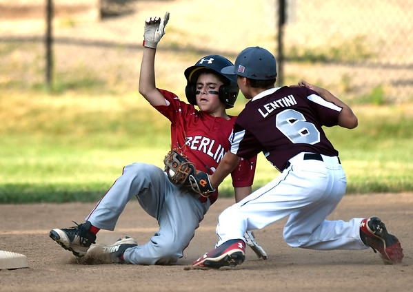7/10/2018 Mike Orazzi | Staff Berlin's Zach Catalano (2) tagged out by Southington South's Connor Lentini (6) in Bristol Tuesday night.