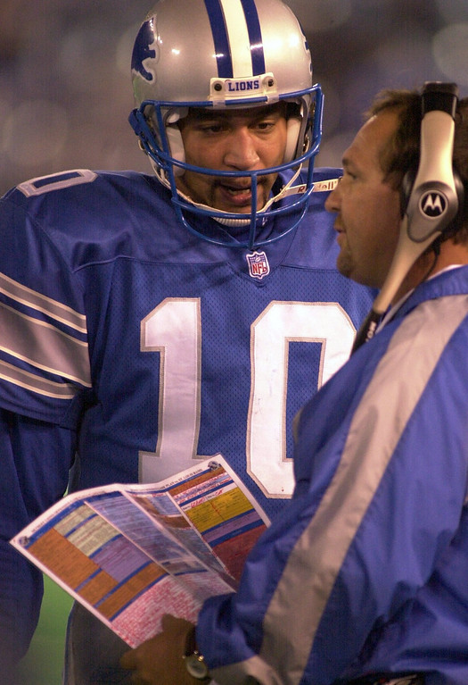 . Detroit Lions quarterback Charlie Batch (10) chats with head coach Marty Mornhinweg during a timeout in the second half of play against the St. Louis Rams played at the Pontiac Silverdome in Pontiac, Mich., Monday, October 8, 2001.