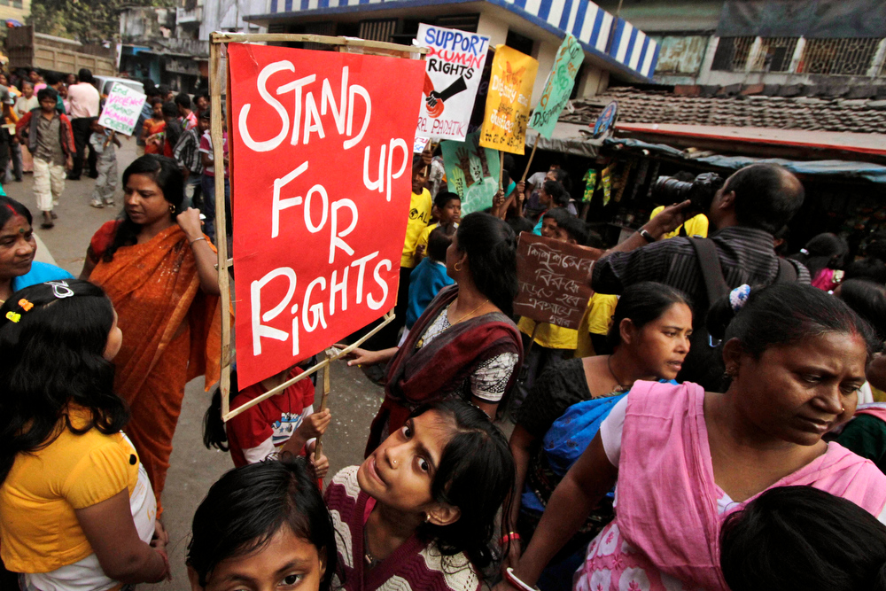 Description of . Children of Indian sex workers walk in a rally to mark International Human Rights Day in Kolkata, India, Monday, Dec. 10, 2012. The rally was held to demand equal rights for the sex workers and their family. (AP Photo/Bikas Das)