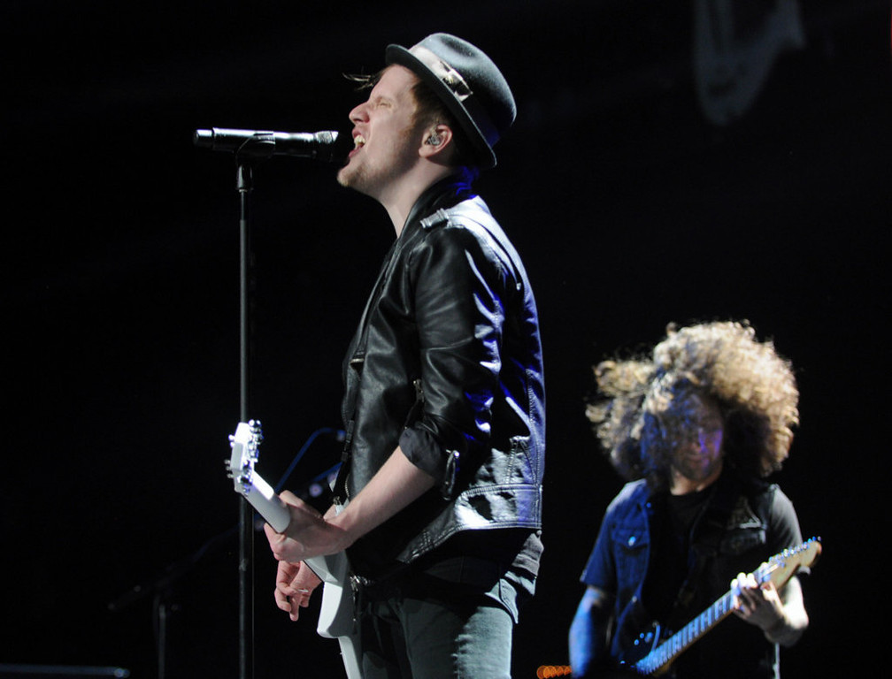 . Patrick Stump, left, and Joe Trohman, background, of Fall Out Boy perform at Jingle Ball. (Pioneer Press: Chris Polydoroff)