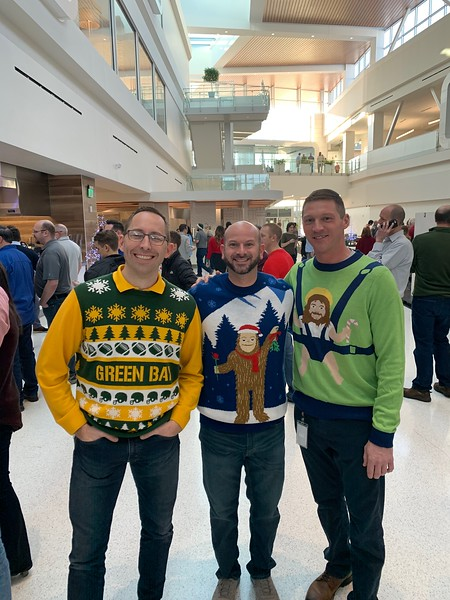 Paul Welch, Brent Raklovits and Mike Weslosky showing off their festive sweaters at Festivus.  .jpg