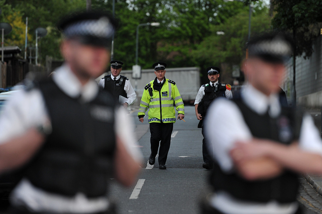 . Police officers cordon off a road area in Woolwich, east London, on May 22, 2013, following an incident in which one man was killed and two others seriously injured.     AFP PHOTO / CARL COURT/AFP/Getty Images