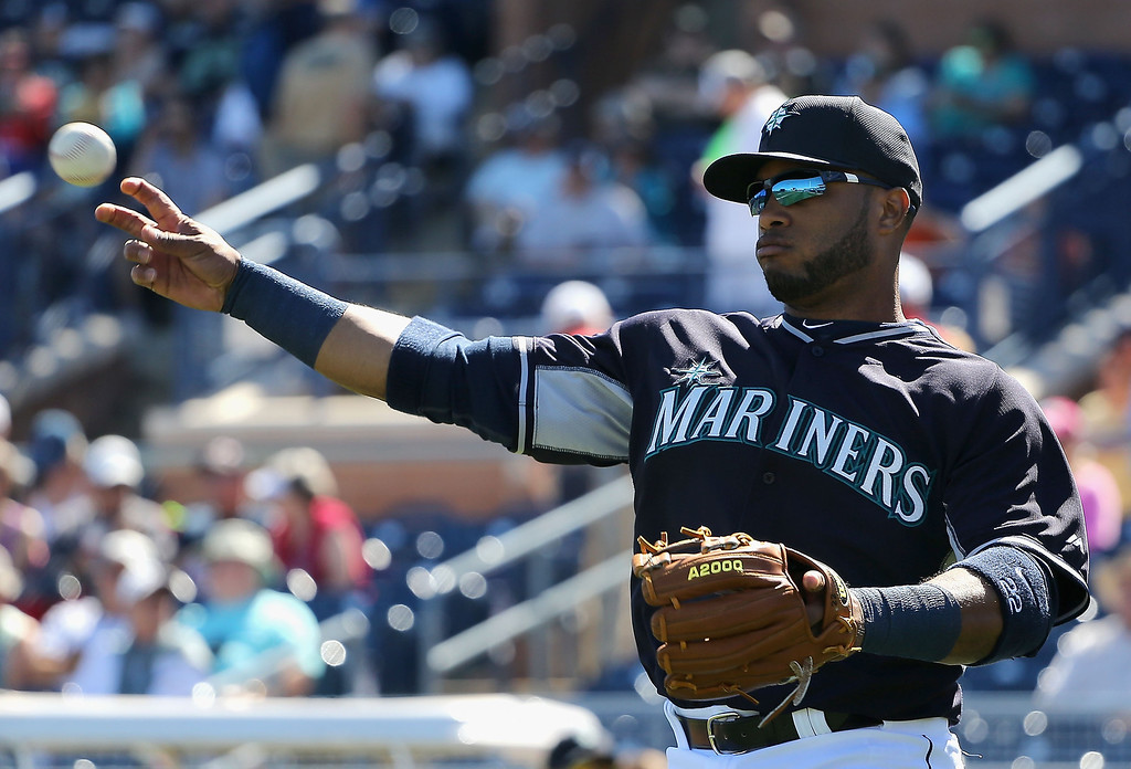 . Robinson Cano #22 of the Seattle Mariners warms up before the spring training game against the Colorado Rockies at Peoria Stadium on March 3, 2014 in Peoria, Arizona.  (Photo by Christian Petersen/Getty Images)