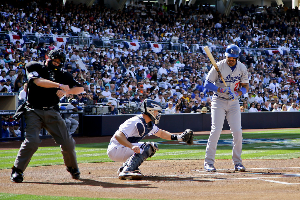 . Umpire Andy Fletcher calls the third strike as Los Angeles Dodgers\' Matt Kemp watches during the first inning of a baseball game  against the San Diego Padres in San Diego, Tuesday, April 9, 2013. Padres catcher Nick Hundley takes the throw. (AP Photo/Lenny Ignelzi)