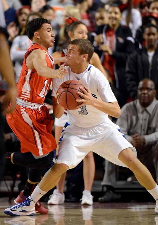 . DENVER, CO. - FEBRUARY 09: Brian Carey (11) of East plays tight defense on Evan Motlong (3) of Highlands Ranch February 9, 2012 at Magness Arena.  East defeated Highlands Ranch 73 - 54. (Photo By John Leyba/The Denver Post)