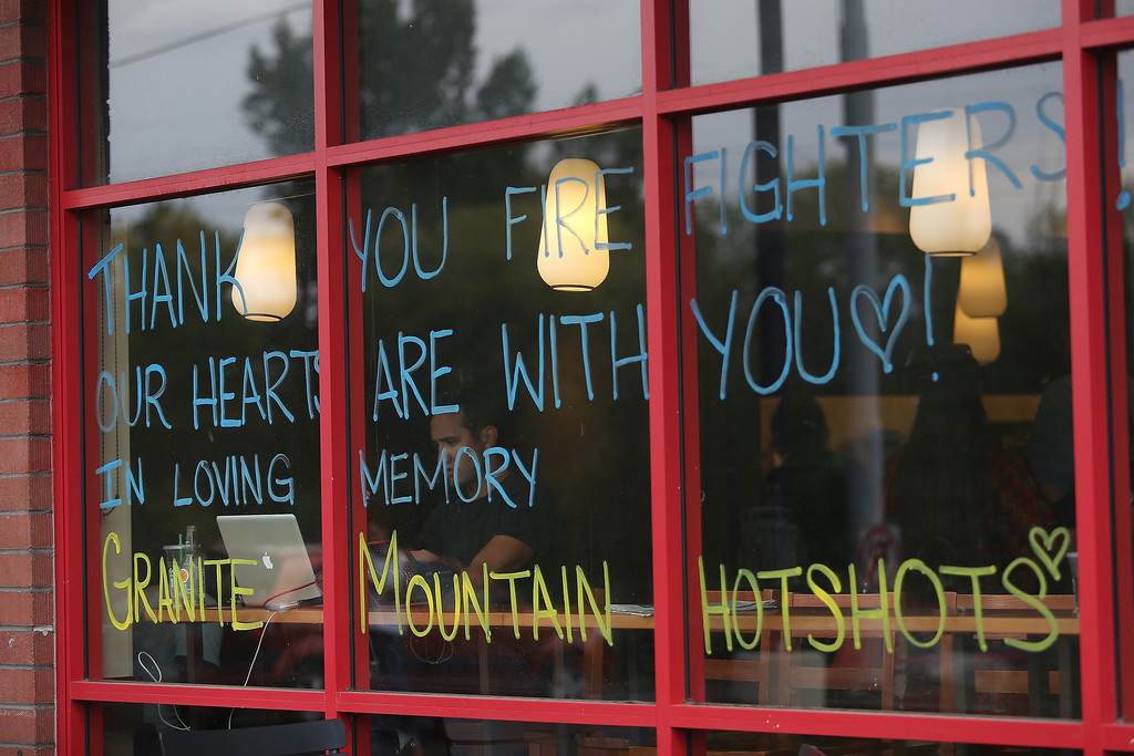 . A sign written on a coffee shop window thanks firefighters and remembers the Granite Mountain Hotshots in Prescott, Arizona, on July 1, 2013. Reinforcements poured in Monday to battle a runaway wildfire which quadrupled in size overnight after killing 19 firefighters in one of the worst such incidents in US history.   Krista Kennell/AFP/Getty Images