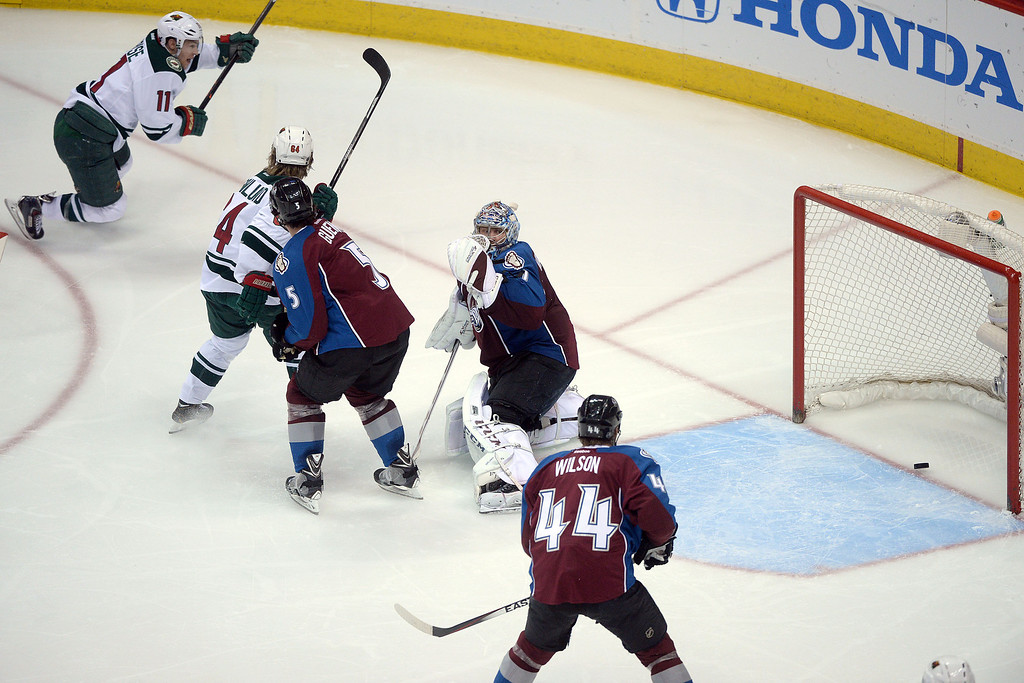 . DENVER, CO - APRIL 26: Semyon Varlamov (1) of the Colorado Avalanche watches as a game-tying 2-2 goal by Zach Parise (11) of the Minnesota Wild makes a goal on an assist from Mikael Granlund (64) during the third period. The Colorado Avalanche hosted the Minnesota Wild during game five of the first round of the NHL Stanley Cup Playoffs at the Pepsi Center on Saturday, April 26, 2014. (Photo by Karl Gehring/The Denver Post)