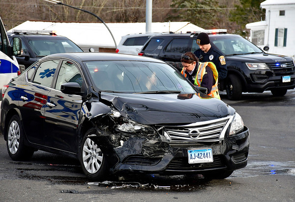3/8/2019 Mike Orazzi | Staff The scene of a two-car crash at the intersection of Peck Lane and Wolcott Street in Bristol Friday afternoon.