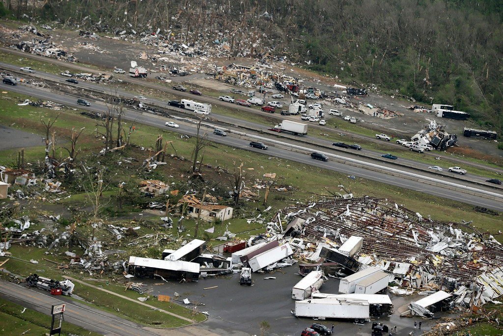 . Traffic passes on Interstate 40 between destroyed businesses in Mayflower, Ark., Monday, April 28, 2014, after a tornado struck the town late Sunday. (AP Photo/Danny Johnston)