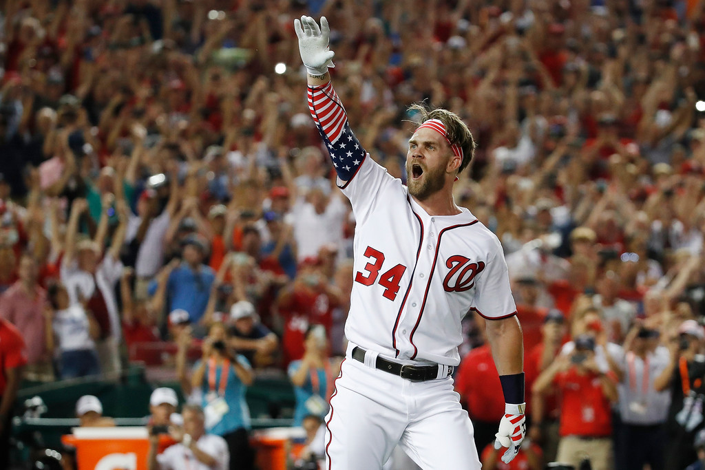 . Washington Nationals Bryce Harper (34) reacts to his winning hit during the Major League Baseball Home Run Derby, Monday, July 16, 2018 in Washington. (AP Photo/Alex Brandon)