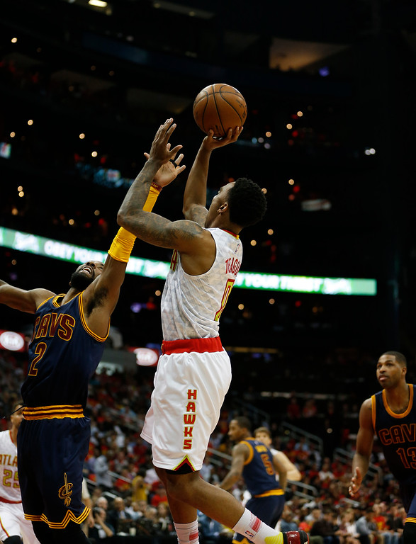 . Atlanta Hawks guard Jeff Teague (0) shoots against Cleveland Cavaliers guard Kyrie Irving (2) in the first half of Game 3 of the second-round NBA basketball playoff series, Friday, May 6, 2016, in Atlanta. (AP Photo/John Bazemore)