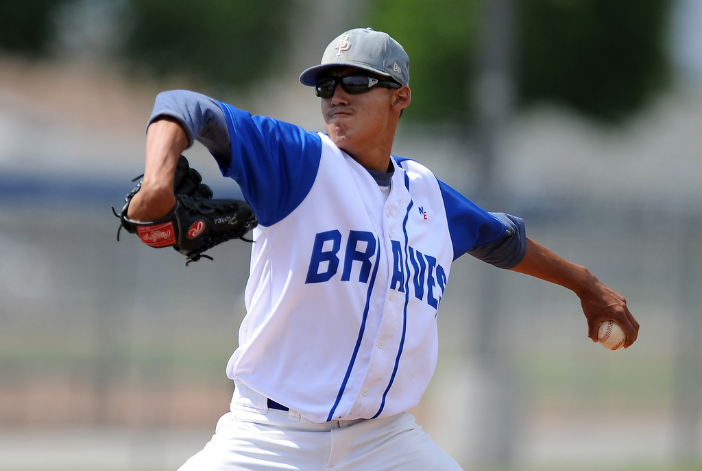 . Baldwin Park starting pitcher Bernardo Flores (C) throws to the plate in the first inning of a CIF-SS semifinal prep playoff baseball game against El Rancho at Baldwin Park High School on Tuesday, May 28, 2013 in Baldwin Park, Calif.  El Rancho won 5-4.  (Keith Birmingham/Pasadena Star-News)