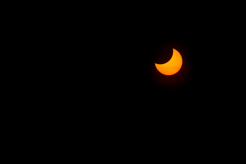 Partially eclipsed sun; uncropped view. This is what my camera saw. Other shots have been cropped.