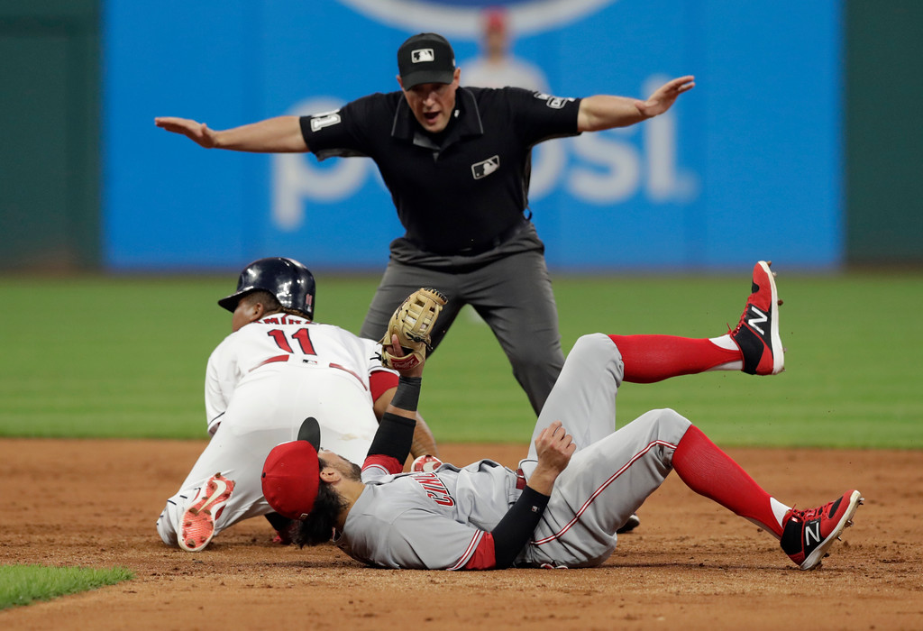 . Cleveland Indians\' Jose Ramirez, left, is safe at second base on a double as Cincinnati Reds\' Alex Blandino can\'t make the tag in the eighth inning of a baseball game, Tuesday, July 10, 2018, in Cleveland. Second base umpire Quinn Wolcott calls Ramirez safe. (AP Photo/Tony Dejak)