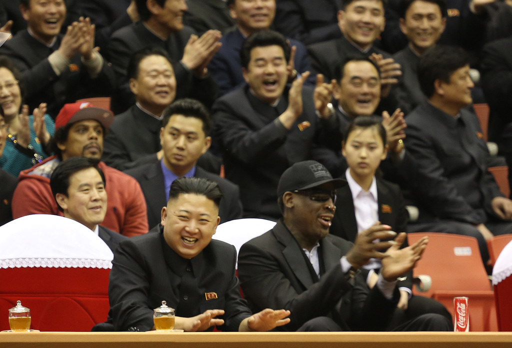 . FOR USE AS DESIRED, YEAR END PHOTOS - FILE - North Korean leader Kim Jong Un, left, and former NBA star Dennis Rodman watch North Korean and U.S. players in an exhibition basketball game at an arena in Pyongyang, North Korea, Thursday, Feb. 28, 2013. Rodman arrived in Pyongyang on Monday with three members of the Harlem Globetrotters basketball team to shoot an episode on North Korea for a new weekly HBO series. (AP Photo/VICE Media, Jason Mojica, File)