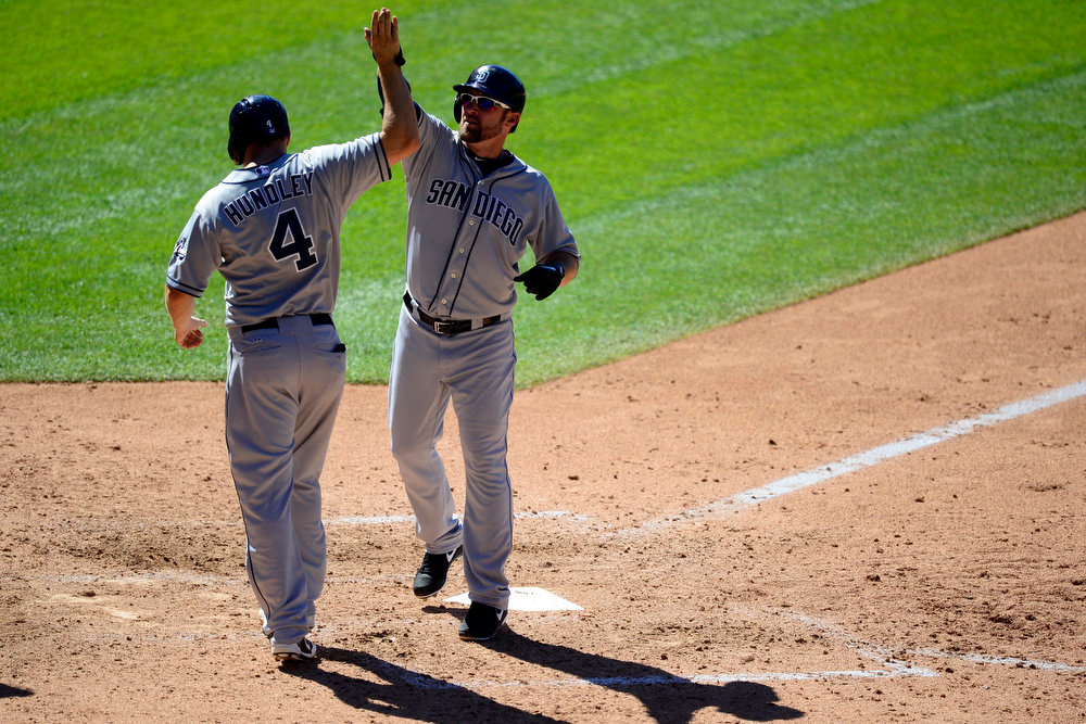 . Colorado Rockies second baseman Josh Rutledge (14) is greeted at home by catcher Nick Hundley (4) after hitting a go-ahead 504 home run off of Colorado Rockies relief pitcher Edgmer Escalona (61) in the seventh during the action in Denver. The Colorado Rockies hosted the San Diego Padres at Coors Field on Sunday, June 9, 2013. (Photo by AAron Ontiveroz/The Denver Post)