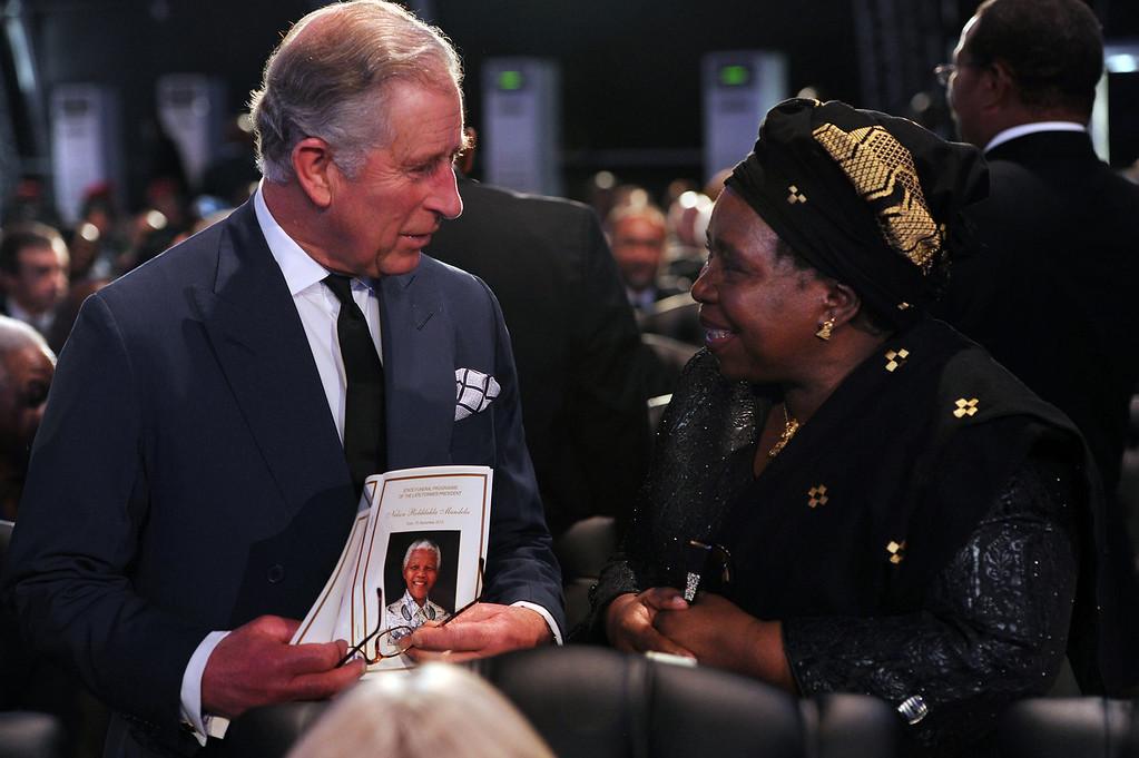 . Britain\'s Prince Charles speaks with Nkosazana Dlamini-Zuma before the funeral service for former South African President Nelson Mandela in Qunu, South Africa, Sunday, Dec. 15, 2013. (AP Photo/Felix Dlangamandla, Pool)