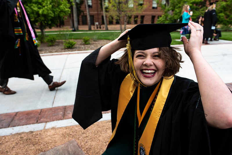 Emily Sussman adjusts her graduation cap before the 2019 commencement ceremony at Colorado College in Colorado Springs, Sunday, May 19, 2019. (Photo by Kelsey Brunner/The Gazette)