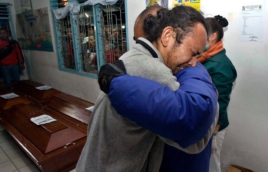 . Indonesian relatives mourn for the Sinabung volcanic eruption victims at a hospital in Kabanjahe, Karo, North Sumatra, Indonesia, 01 February 2014.  EPA/DEDI SAHPUTRA