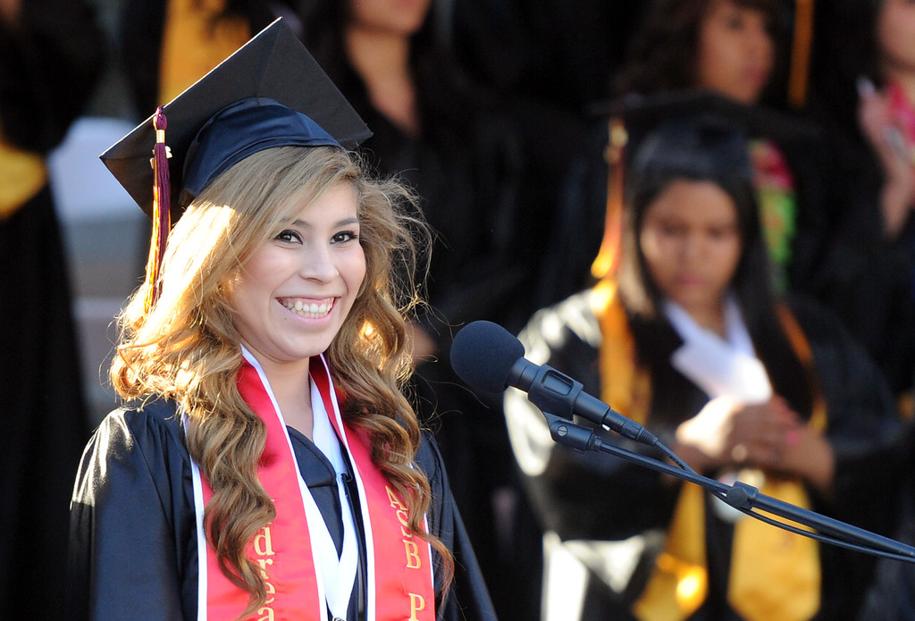 . Andrea Arreguin smiles before the flag ceremony during the Vail High School commencement at Vail High School on Tuesday, June 18, 2013 in Montebello, Calif.