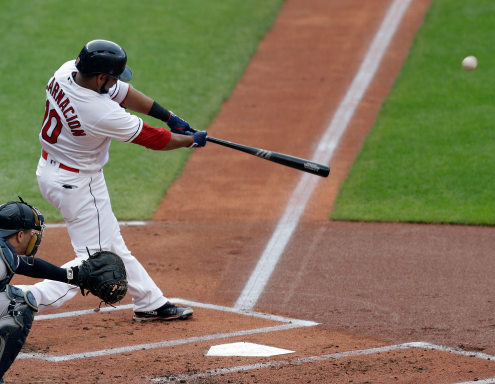 . Cleveland Indians\' Edwin Encarnacion hits a solo home run off New York Yankees starting pitcher Luis Severino during the first inning of a baseball game Thursday, July 12, 2018, in Cleveland. (AP Photo/Tony Dejak)